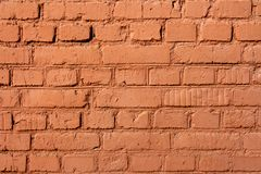 Part of the old red brick wall. Background is composed of parts of the old red brick wall on a sunny autumn day Stock Image
