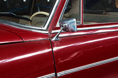 Part of the old red car and car mirror Royalty Free Stock Image
