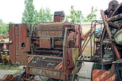 Part of an old rusty harvester at a scrap heap. Rusted parts of agricultural machinery Stock Images