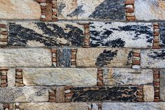 Part of old stone wall background. Motley rectangle bricks combi. Ned with small stones. Unusual brick sitting Royalty Free Stock Photography
