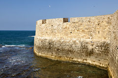 Wall above the Sea. Part of the old town of Acco (Israel) city wall rising above the Mediterranean sea Royalty Free Stock Photography