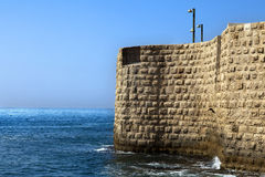 Wall above the Sea. Part of the old town of Acco (Israel) city wall rising above the Mediterranean sea Stock Photos