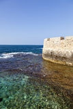 Wall above the Sea. Part of the old town of Acco (Israel) city wall rising above the Mediterranean sea Stock Photography