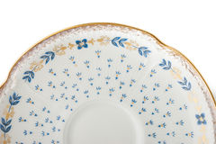 Part of old vintage porcelain plate on the white background. Horizontal royalty free stock photography