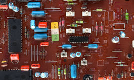 Part of old vintage printed circuit board. With electronic components Royalty Free Stock Photos