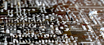 Part of old vintage printed circuit board. With electronic components Royalty Free Stock Images