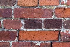 Part of an old weathered brick wall with cement lines seams rectangular blocks royalty free stock photos