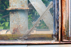 Old window with a smeared crack Stock Images