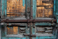 Part of old wood door with locks. There is part of  old wood door with locks and blue color Stock Photos