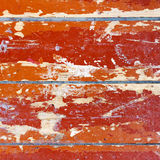 Part of the old wooden floor with damaged paint. Square background Stock Photos