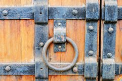 Part of the old wooden gates with ring handle Royalty Free Stock Photo