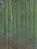 Part of old green painted barn door with vertical planks. Part of old worn down grungy green painted barn door with vertical planks Royalty Free Stock Image