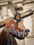 Statue of Jesus bearing cross. Part of one of the large wooden holy scenes carried by groups of local people as part of Semana Santa (Easter Processions) in Stock Photos