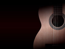 Part of a orange acoustic guitar on black background. Stock Photo