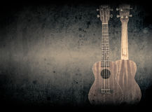Part of a orange acoustic guitar on black background. Royalty Free Stock Photos