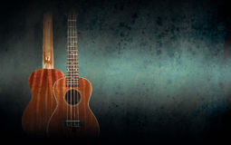 Part of a orange acoustic guitar on black background. Royalty Free Stock Photography