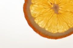 Part of orange slice. Isolated slice of orange, backlit Stock Image