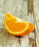 part of orange on wooden Royalty Free Stock Image