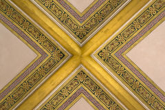 Part of an ornamented vault with gilded ribs Royalty Free Stock Photo