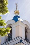 Orthodox church roof with cross over blue sky Stock Images