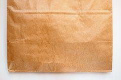 Part of package of Kraft paper on white background, copy space stock photos