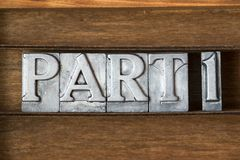 Part 1. Phrase made from metallic letterpress type on wooden tray Royalty Free Stock Image