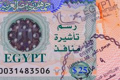 Part photo of Egypt visa with stamp in passport. Visa fee in Egypt $25. Close up view stock photos