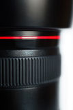 Part of photo lens. Black photolens with red line stock photography