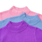 Part of pile of three sweaters Stock Image