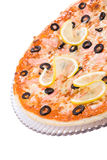 A part of pizza with lemon and olives Royalty Free Stock Image