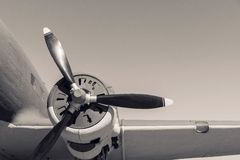 Part plane with the propeller in beige tones Royalty Free Stock Photo