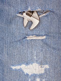 A part of pliers tool with old blue jeans background. Royalty Free Stock Photos