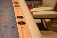 Part of poker table. With cupholders Royalty Free Stock Photography