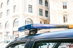 Part of the police car is a siren on the background of the buildings. Conceptual photo of public order protection. Representatives of power, protection of the royalty free stock photo