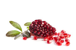 Part of a pomegranate with pomegranate seeds and leaves Stock Photo