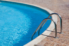 Part of the pool with blue water Stock Images