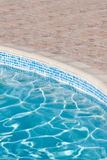 Part of the pool with blue water Stock Photos