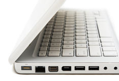 Part with ports of white laptop. White elegance laptop. Hikey scene Royalty Free Stock Photo