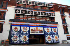 The part of the Potala Palace, with the people republic of China flag inside as well as many windows, curtain, Brick wall, Potala Royalty Free Stock Images