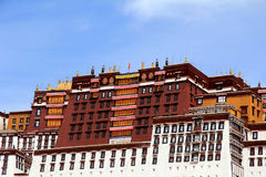 The part of the Potala Palace, with the people republic of China flag inside as well as many windows, curtain, Brick wall, Potala Royalty Free Stock Image