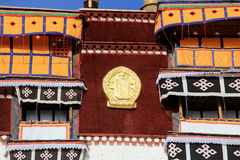 The part of the Potala Palace, with the people republic of China flag inside as well as many windows, curtain, Brick wall, Potala Stock Photo