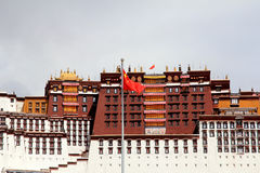 The part of the Potala Palace, with the people republic of China flag inside as well as many windows, curtain, Brick wall, Potala Royalty Free Stock Photography