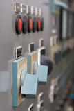 Part of  power plant control panel with switches and red buttons Royalty Free Stock Image