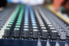 Part of a proffesionellen sound mixing console, studio music dev Royalty Free Stock Photo