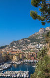Part of the promenade and the mountain with housing in Monaco stock photography