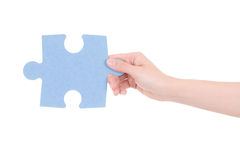 Part of puzzle in woman hand isolated on white royalty free stock photography