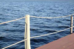 The part of the quay and the fencing with ropes from the water surface Royalty Free Stock Photos