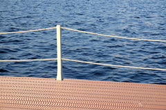 The part of the quay and the fencing with ropes from the water surface Royalty Free Stock Images
