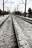 Part of the railway with rails in the snow. Rails and sleepers on the railway in dirty snow Stock Photography