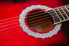 Part of red acoustic guitar. Close up Stock Photography